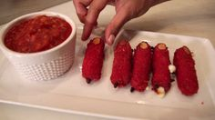 Halloweens around the corner and I'm serving up some Zombie cheese Fingers with Goblin marinara blood. Get the kids in the kitchen and make this together. The Conjuring, Goblin, Food Videos, Fingers, Blood, Strawberry, Corner, Treats, Cheese