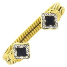 An 18k yellow gold bracelet set with approximately 0.48ctw of H/VS diamonds and carved onyx. Crafted by David Yurman DESIGNER: David Yurman MATERIAL: 18K Gold GEMSTONE: Diamond, Onyx DIMENSIONS: brace