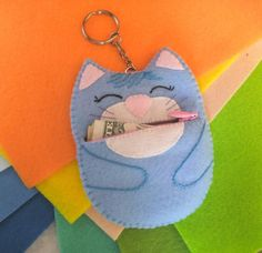 This cute felt cat zipper coin pouch is waiting to be adopted by you and take care of your coins and keys! It is handmade and ready to ship!  Size: 11 cm x 8,5 cm (4.33 x 3.35)  The Kitty is so soft and pleasant to the touch that you will fall in love with it at first touch. But I am sure that you already love it!  ****************************************************************************************  Custom order:  If you dont like the color, would like to change the design of the…