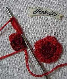 Red roses, pink flowers and tiny cute white flowers Step-by-step tutorial of cast on stitch .