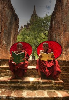 ♂ read together Buddhist monks reading at one of the 2000+ temples located at Bagan in the country of Burma (Myanmar)