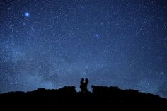 Long exposure star filled sky and engagement couple = amazing.