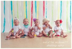 Love the idea of different accessories for each baby with an overall colour scheme.