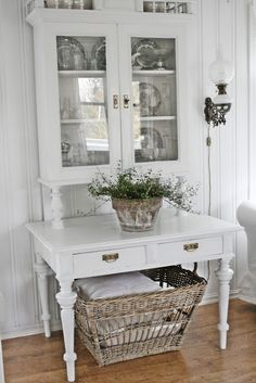 THE EVERYDAY HOME:  I love how two separate pieces of furniture were combined to create one, and oh! I love that French basket underneath.