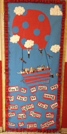 Dr. Seuss classroom door decoration. Love the use of the student pictures