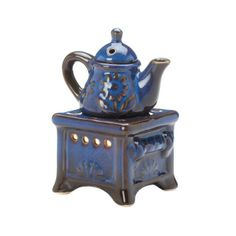 """by Fragrance Foundry This beautiful blue oil warmer will fill your space with lovely aroma and look fantastic all the while. Made from porcelain, you get an oven that holds a tealight candle and a teapot that fits on top that you can fill with the scented oil of your choice. 3.88"""" x 3.12"""" x 5.38""""  allgooddecor.com  #allgooddecor #decor #candles #accents #figurines #furniture #gifts #decorations #lighting #mirrors #fountains #outdoor #toys"""