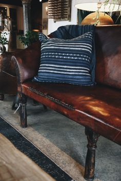 Beautiful antique leather settee and our custom textile accessories. Rustic sophistication in our Houston location. Georgia Brown Home by BD Antiques. http://www.bdantiques.com/