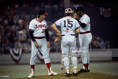 Coach Dick Williams #23 of the California Angels comes out to talk with pitcher Luis Tiant #23 of the Boston Red Sox and Thurman Munson #15 of the New York Yankees all of the American League All-Stars against the National League All-Stars during Major League Baseball All-Star game July 23, 1974 at Three Rivers Stadium in Pittsburgh, Pennsylvania. The National League won the game 7-2.