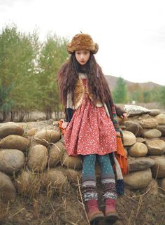Not so fond of the fur, but love the dress and the colours