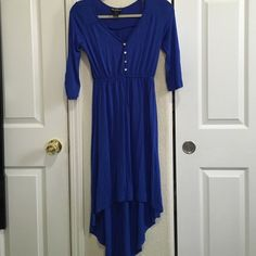 Royal blue hi low dress Never worn . 95% rayon , 5% spandex. Hi low. Royal blue with gold buttons:)  3/4 sleeves Delirious Dresses High Low