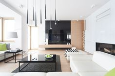 """D24 is a private home located in Jaworzno, Poland. It was designed in 2014 by WIDAWSCY STUDIO ARCHITEKTURY.                     D24 by WIDAWSCY STUDIO ARCHITEKTURY: """"Minimalism and a maximum of open space are the basic assumptions of presented interior. Designers arranged it with elegant simplicity. They decided to use contrasting statement of white, black and Oak. The ground floor of house is dominated by black and white broken by green accents. Because of the correct functional plan of…"""