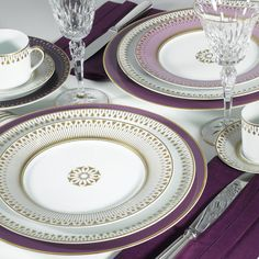 """Golden rays adorn the """"Soleil Levant"""" dinner service from Bernardaud. The big circular plates clearly reveal the inspiration behind this richly adorned dinner service: the rising sun. What is also particularly impressive is the combination of the white and golden """"Soleil Levant"""" dinner plates with the colourful dessert plates. They seem like a delicately shaded piece of sky - in dusky pink, violet, honey yellow or chocolate. It is also possible to order presentation plates in matching…"""