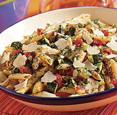 Warm Pasta Salad with Grilled Tomatoes, Zucchini & Pecorino: This vegetarian salad is summer in a bowl. It works both as a side or a main dish and since the vegetables can be grilled up to two hours ahead, it's perfect for nights when you're having guests. Via Fine Cooking