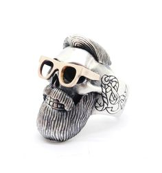 """Sterling silver and red gold hand engraved """"Hipster skull"""" ring.This one of a kind ring is part of a new collection called """" Memento"""" from Sirkel Jewellery which is comprised of human and animal skull pieces. Ring Ring, Ring Bracelet, Ring Necklace, Ringe Gold, Jewelry Accessories, Jewelry Design, Biker Rings, La Mode Masculine, Hipster"""