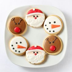 """Your favorite Christmas """"faces"""" all in one cookie collection! A collection of small decorated sugar cookies.This collection contains three designs: Santa Face, Rudolph Face & Snowman Face The mixed case contains 16 of each design and a total of 48 cookies cello bagged & sealed $3.50 per cookie. Call 1-800-567-9089 or email marketing@craftwell.com for quote or order!"""