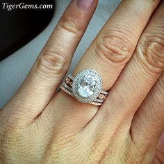 The 1.75 ctw double halo oval ring with a rose gold plated art deco band, a half eternity band in sterling silver, and another half eternity band in rose  Shop my stacking rings ✨ at TigerGems.com