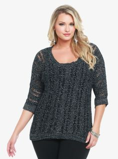 Threaded with silver lurex yarn, this black open-knit sweater is a dazzling must. The 3/4 dolman sleeves and the wide scoop neckline give the pullover an easy, relaxed feel.