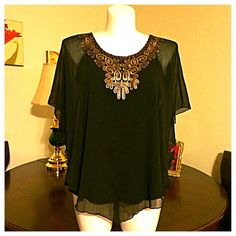 Plus Size Black Top with Gold Bib Dramatic black top with a built in undershirt. The outer shell is a chiffon material with a metallic gold bib adornment. NWOT no trades no paypal Cocomo Woman Tops