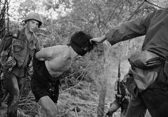 vietnam war images | Above: US troops straining blindfolded Vietnamese soldier