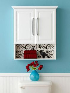 Bathroom storage.  I love the paper on the back of this unit. What an easy way to personalize something. :)