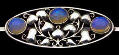Oscar Dietrich. Secessionist brooch. Attributed to Franz Delavilla. Silver and opal. H: 1.6 cm (0.63 in)  W: 2.7 cm (1.06 in). Marks: 'OD' 'A' & Vienna poincon Austrian, ca. 1910. Sold by Tadema Gallery.