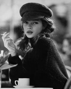 Young Kate Moss | smoking at a cafe | coffee and cigarettes | black & white fashion photography | UK model | sweet and innocent |
