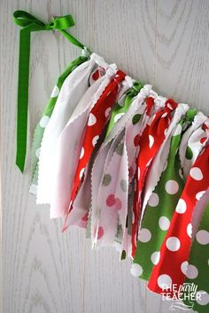 Red, green and white fabric tie garland. The perfect touch for your Christmas party or holiday decorations. My garlands are very full and neatly hand-tied. And, they are reusable! Just drape from a ha