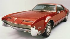 """The 51 Coolest Cars of The Last 50 Years - Road & Track - 1966 Oldsmobile Toronado - No front-driver—let alone one from Michigan—has ever said """"Go to hell"""" more eloquently. Ferrari 288 Gto, New Ferrari, General Motors, Michigan, 1965 Shelby Cobra, Shelby Gt350r, Automobile, Oldsmobile Toronado, Sports Sedan"""