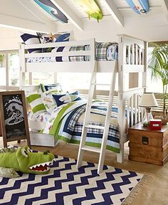 LOVE the bedding and the surfboards on the ceiling!!