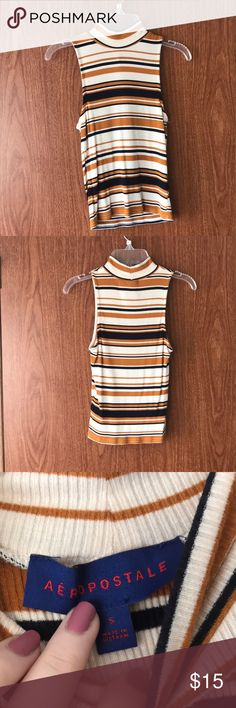 Striped Mock Neck Crop Top Striped Mock Neck Sleeveless Crop Top from Aeropostale.  Cream, Navy blue, and Yellow.  Size S.  Bodycon  Never worn!  If you have any questions, please ask! Offers are welcome!  All bundles come with an extra discount! Aeropostale Tops Crop Tops