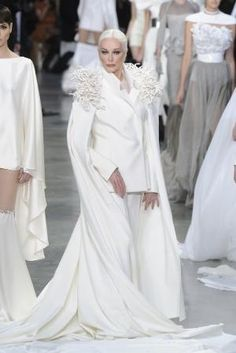 Carmen Dell'Orefice by celia... This is a fantastic wedding look for a chic woman who eschews wearing a dress in favour of a comfortable wedding pantsuit with cape train. Perfect for a winter bride.