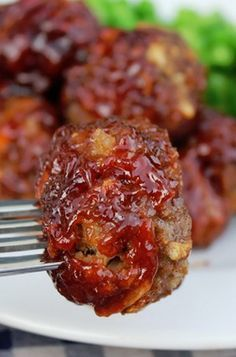 Sweet and Savory BBQ Meatballs - These crispy meatballs are dripping with a sticky sweet and savory sauce. The inside is moist, flavorful and fabulous. They come together very quickly, you only need about 15 minutes prep and 40 minutes baking time to make them a reality.