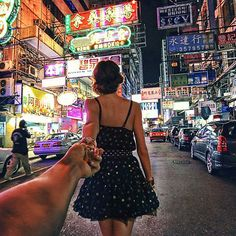"""In his photo series """"Follow Me To"""", Russian photographer Murad Osmann is taking the viewer on an intimate journey together with his girlfriend who's leading him around the world. The pose is almost the same in every picture: the girl never shows her face, and the guy almost never lets go of her hand. The settings change from Moscow to London to Venice to a number of different locations in Russia, revealing their passion for travel."""