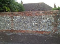 The reconstruction of a flint wall in Emsworth, Hampshire Brick Design, Brick Wall, Garden Paths, Hampshire, Planer, Outdoor Living, City Photo, Garden Design, Exterior
