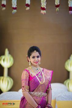 South Indian bride. Gold Indian bridal jewelry.Temple jewelry. Jhumkis.Pink and purple silk kanchipuram sari.Side braid with fresh jasmine flowers. Tamil bride. Telugu bride. Kannada bride. Hindu bride. Malayalee bride.Kerala bride.South Indian wedding.