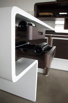 white ductal island with wine rack embeds by szolyd.com