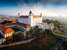 Book East Europe holiday tour packages from Mumbai & Ahmedabad Travels. We offer best itinerary, vegetarian food with Luxurious hotel stays on East Europe trip. Most Beautiful Cities, Beautiful Buildings, European River Cruises, Bratislava Slovakia, Europe Holidays, Heart Of Europe, Architecture Old, Eastern Europe, Holiday Destinations