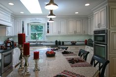Black and White kitchen with a beautiful red accent. Give us a call @ 704-434-0823 http://walkerwoodworking.com/