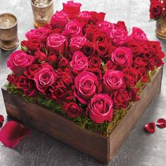 Nestled in lush moss, a classic bed of artfully arranged scarlet, magenta and red roses enamors. Displayed in a dark stained hand crafted wood box, Jardin Rose arrangement measures approximately 9 3/4 x 9 3/4 x 8 and requires next day shipping.