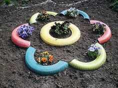 I'm not a huge fan of tires but these painted tires would look really cute in my garden.  Very unique!