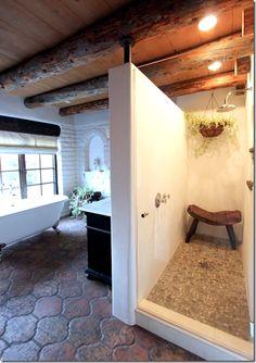 Shower behind sink wall.