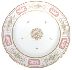 A Meissen plate in the White House china collection represents John Quincy and Louisa Adams in this historic series.The Adams selected this service during their extensive diplomatic duties in Germany.This plate features a large,gold rosette at the center,and the rim's five panels combine lavender/pink,red,and gold. Each panel encloses two other figures that resemble seahorses separated with blue and yellow motifs.As for their official state china, the Adams used the 270-piece Monroe dinner s...