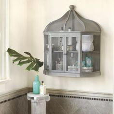 Our Aviary Birdcage Shelf is perfect in the bath for soaps and hand towels, in the kitchen for herbs and spices, or as a special display case for keepsakes.