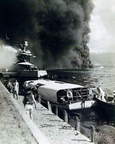 history Burning and damaged ships at Pearl Harbor after the Japanese attack on 7 December Shown is USS California (BB foreground, burning at Naval Air Station Ford Island. USS Oklahoma (BB is shown capsized in the background. Pearl Harbour Attack, Uss Helena, Pearl Harbor Hawaii, Uss Oklahoma, Remember Pearl Harbor, Uss Arizona, Military Pictures, Navy Ships, Battleship
