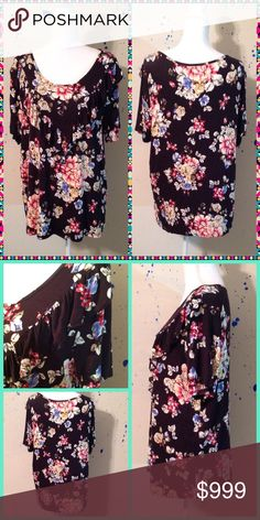 2 LEFT! Floral Print Top 1X,2X. Super soft and comfy! Has ruffles on the front. 96% Rayon and 4% Spandex. Tops