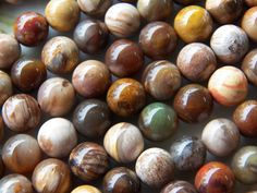 8mm RARE A Grade Brazil Petrified Wood Agate Gemstone Beads, 8 IN. $10.25, via Etsy.