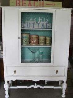 Antique china cabinet painted in vintage green and white. Custom chalk paint.