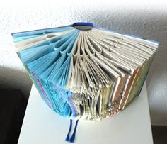 A serie of art pieces made by transforming into new forms old and useless telephone books and catalogs. All the objects are a result of many hours of patience and precise handwork. They are nice decoration for every nook and cranny for your home. Size: 34cm x 21cm x18cm (13,3 x 8,2 x 7)