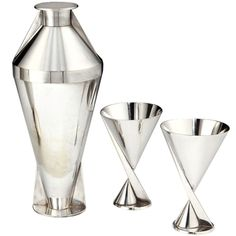 An incredibly rare and important Art Deco cocktail set comprising silver-plated Modernist cocktail shaker and a pair of goblets, each piece bearing maker's marks to the base, all French, circa 1928.  Height of shaker: 10 inches (26 cms). Height of each goblet: 5 inches (13 cms).