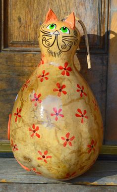 Gourd Cat captures the whimsy and originality- a perfect addition to any cat lovers home! A tall and quiet cat, she stands over 15. She is embellished